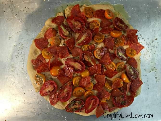 assemble the focaccia pizza