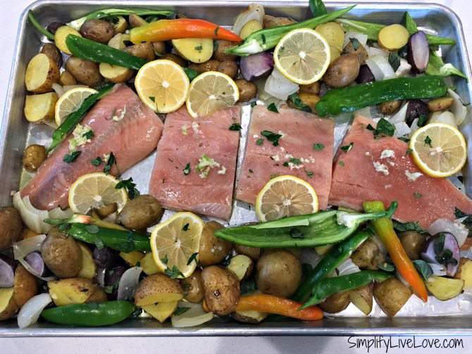 Add salmon and other veggies to sheet pan